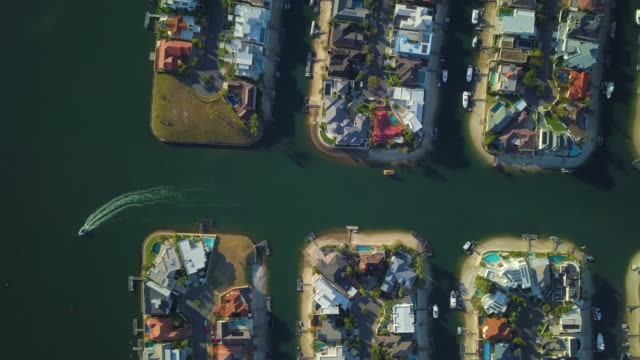 aerial descent: incredible canal frontage homes with pontoons, gold coast, australia - canal stock videos & royalty-free footage