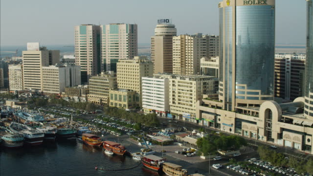 Aerial Dhows anchored Dubai Creek Waterfront city buildings