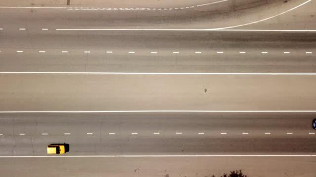 stockvideo's en b-roll-footage met antenne rechtstreeks boven weergave van vervoer snelweg - bovenste deel