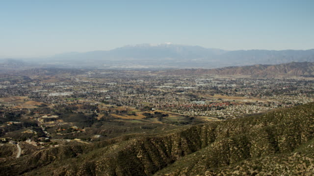 aerial distant mountain view of palm springs california - aerial transport building stock videos & royalty-free footage