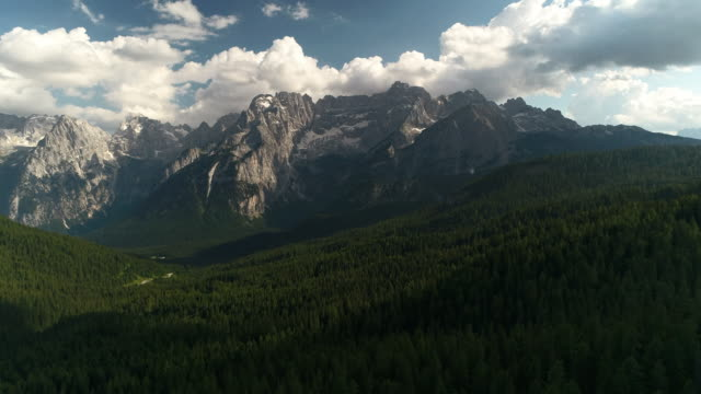 aerial dolly shot showing a majestic dolomite landscape, italy - majestic stock videos & royalty-free footage