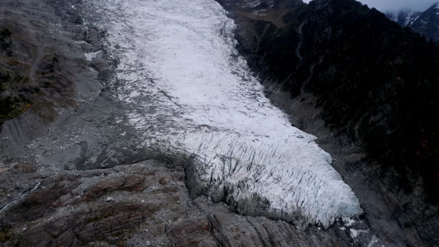 aerial dolly shot showing bossons glacier, chamonix, france - weathered stock videos & royalty-free footage