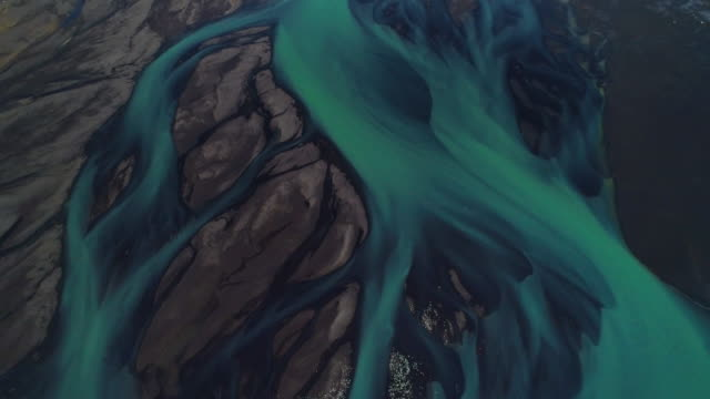 aerial dolly shot showing braided river flows, iceland - abstract stock videos & royalty-free footage