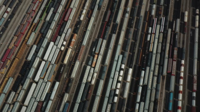 aerial dolly shot showing freight trains in a shunting yard, texas, united states of america - train vehicle stock-videos und b-roll-filmmaterial