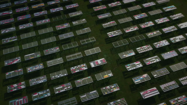 aerial dolly shot showing rows of solar panels at a research facility, florida, united states of america - miami dade county stock videos & royalty-free footage