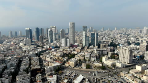 aerial dolly/ tel aviv cityscape with financial district - テルアビブ点の映像素材/bロール
