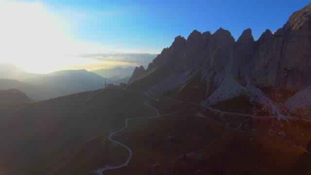 aerial: dolomites mountain at sunset - north tirol stock videos & royalty-free footage
