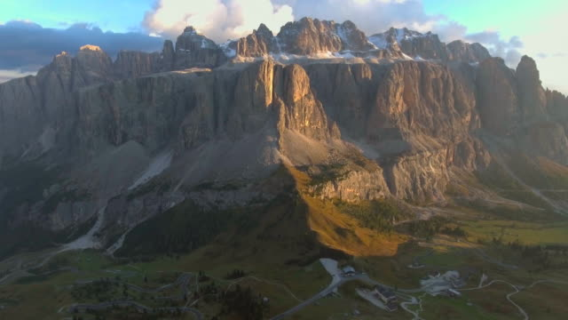 aerial: dolomites mountain at sunset - unesco world heritage site stock videos & royalty-free footage