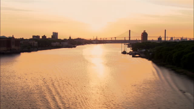 aerial down savannah river at dusk/ zoom in waterfront with docked boats and savannah city hall in background/ savannah, georgia - savannah georgia stock videos & royalty-free footage