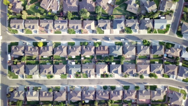aerial downward looking view of a residential neighborhood - suburban stock videos & royalty-free footage