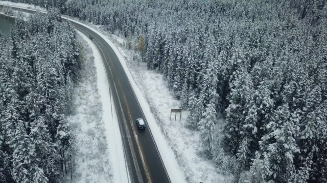 aerial driving on winter - car on road stock videos & royalty-free footage