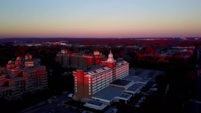 aerial drone approach to the garden city hotel in garden city new york at sunset - nassau stock videos & royalty-free footage