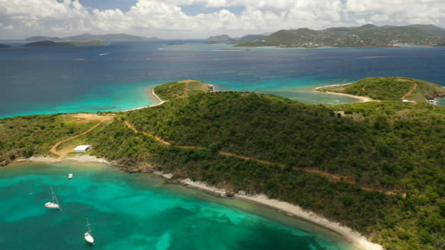 aerial drone camera pan of great saint james, the private island owned by jeffrey epstein in the u.s. virgin islands. - island stock videos & royalty-free footage