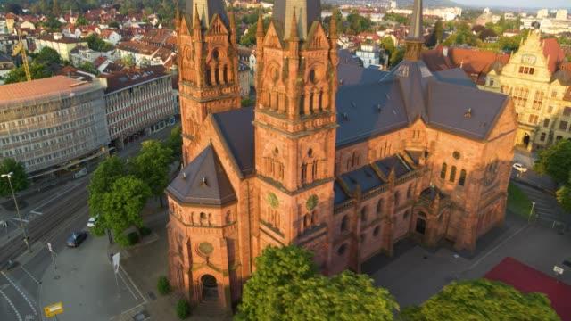 luftdrohne kreist von einer großen kirche in der nähe von freiburg - gläubiger stock-videos und b-roll-filmmaterial