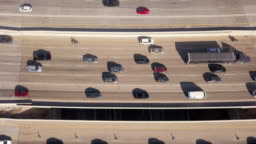 Aerial Drone Clip Looking Down On I-15, I-80 Of The Commuter Traffic And Train In Salt Lake City