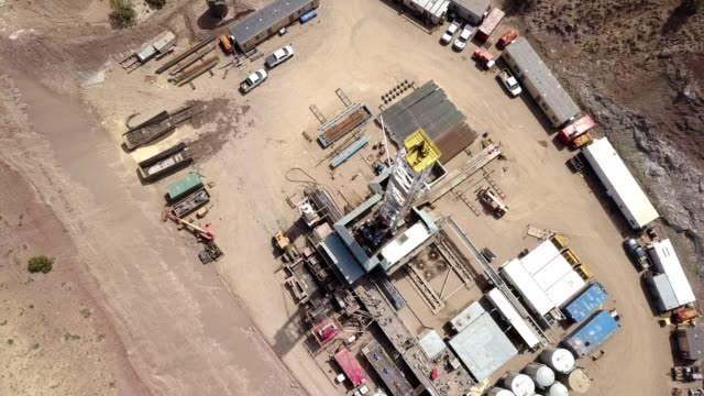 Aerial Drone Clip of a Fracking Drill Rig in the Hills of Colorado in the Springtime
