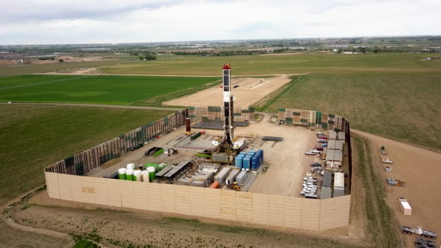 aerial drone clip of a fracking drill rig on the eastern slope of colorado in late springtime - western usa stock videos & royalty-free footage