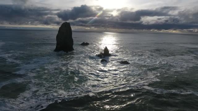 aerial drone establishing shot of cannon beach waves and haystack rock sea stack - oregon coast stock videos & royalty-free footage