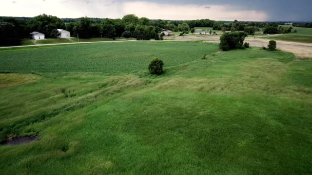 Aerial drone flight over a field in Atwater Minnesota on a stormy day
