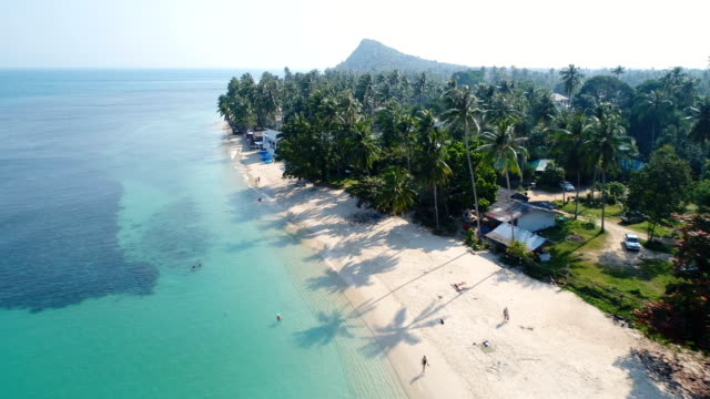 aerial drone flight over beautiful beach in thailand, koh samui
