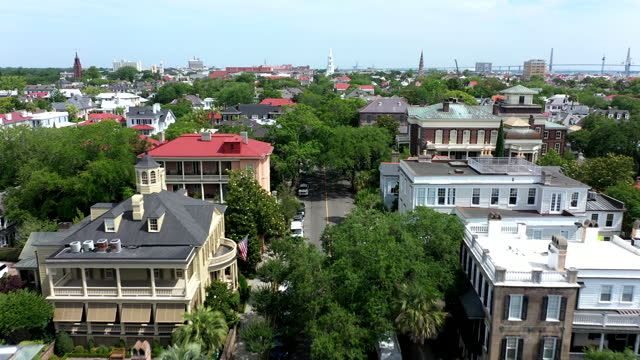 aerial drone flight over historic charleston, south carolina - street name sign stock videos & royalty-free footage