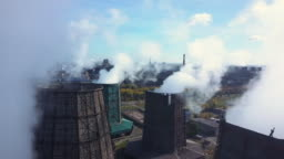 Aerial; drone flight over the smoke stack; cooling system of plant