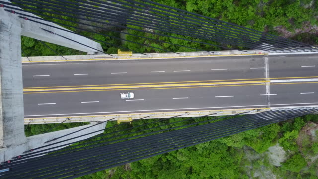 aerial drone footage of a bridge in mexico - elevated road stock videos & royalty-free footage