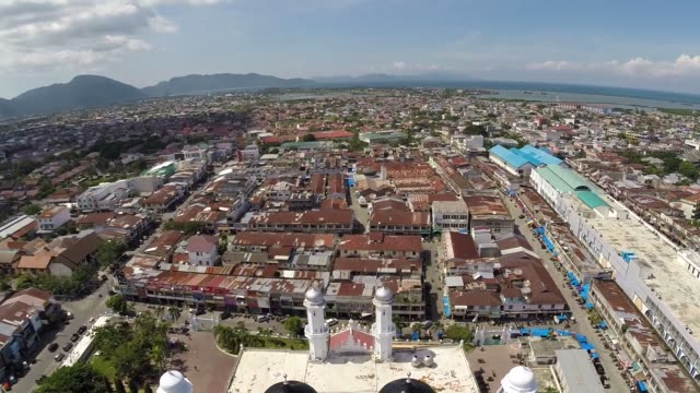 Aerial drone footage of Banda Aceh Malaysia taken 10 years after the earthquake and tsunami hit Banda Aceh in 2004 The 11year anniversary of the...