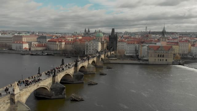 aerial drone footage of city center buildings and roof tops on the prague skyline czech republic - prague stock videos & royalty-free footage
