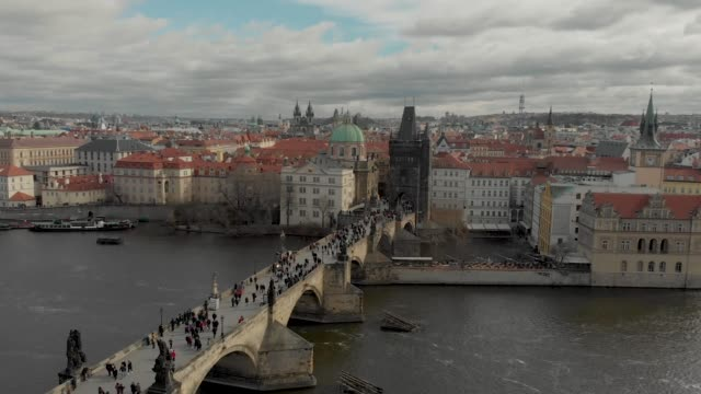 aerial drone footage of city center buildings and roof tops on the prague skyline czech republic - river vltava stock videos & royalty-free footage