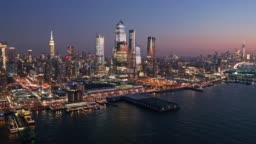 Aerial drone footage of New York skyline at dusk