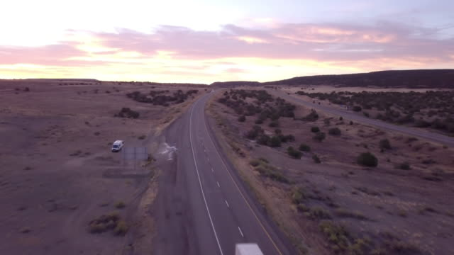 Aerial Drone Footage of Semi-Trucks Rolling Down the Highway