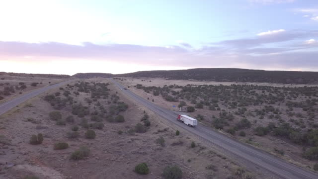 aerial drone footage of semi-trucks rolling down the highway - trailer stock videos & royalty-free footage