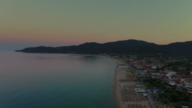 aerial drone footage of the gulf, beach and town of sarti, sithonia, halkidiki peninsula at summer at late afternoon - town stock videos & royalty-free footage