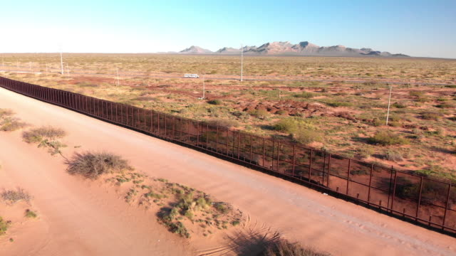 aerial drone footage of the international border wall near the santa teresa border crossing - international border stock videos & royalty-free footage