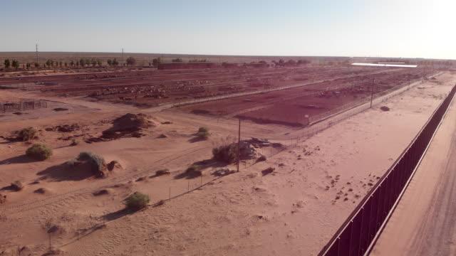 aerial drone footage of the international border wall near the santa teresa border crossing - international border stock videos & royalty-free footage