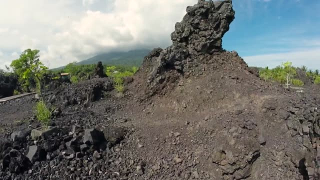 Aerial drone footage of the nearconical stratovolcano of Mount Gamalama which comprises the entire Ternate Island Indonesia Ternate island lies off...