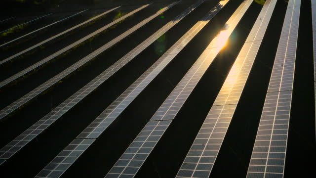 aerial drone footage of uk solar panels at sunset - twilight stock videos & royalty-free footage