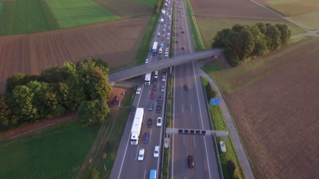 aerial drone footage of vehicles moving on autobahn 81 amidst patchwork landscape - patchwork landscape stock videos and b-roll footage
