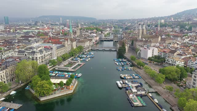 aerial drone footage of zurich city center and old town in switzerland - tram stock videos & royalty-free footage