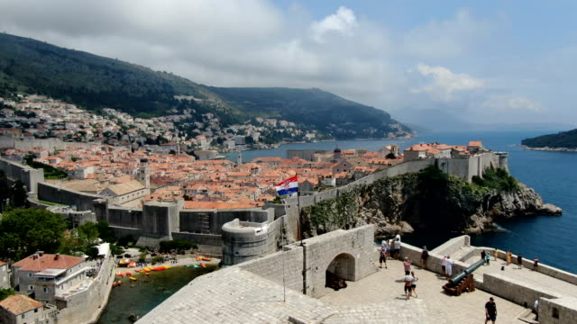 aerial drone footage walls of dubrovnik old town with red tile roofs, croatia - croazia video stock e b–roll