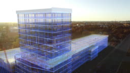 Aerial Drone Footage with VFX Concept: Building Construction Site Becomes Finished Project with 3D Graphics Animation Effects. Visualization, Digitalization of Design, Development of Futuristic City
