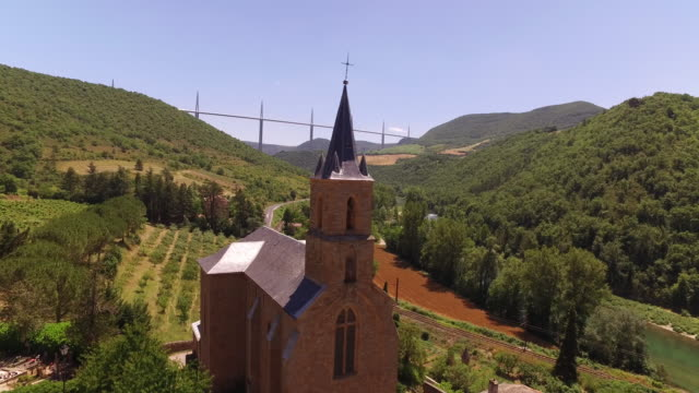 aerial drone from church spire to millau viaduct - viaduct stock videos & royalty-free footage