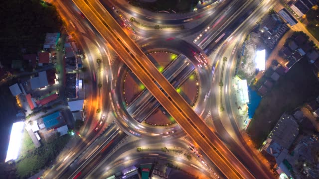 aerial drone hyper lapse top view roundabout interchange of a city at night, bangkok, thailand - thoroughfare stock videos & royalty-free footage