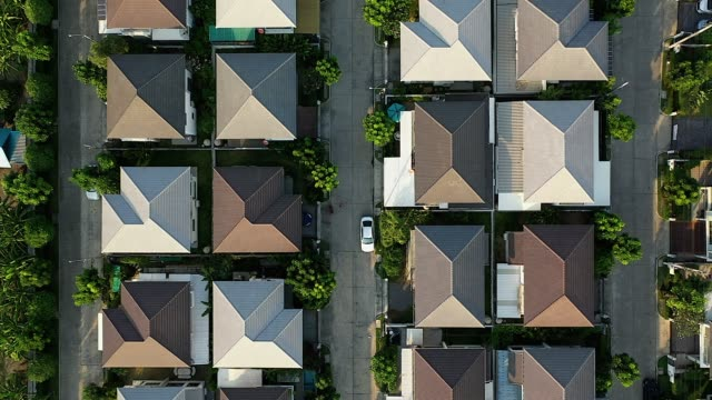 aerial drone image of residential suburban houses in a small community. - uk stock videos & royalty-free footage
