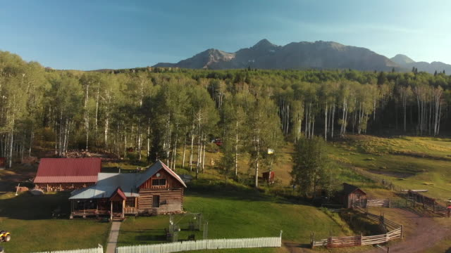 aerial drone image of the famous schmid ranch near telluride in southwest colorado in the early fall on a sunny afternoon with blue sky - aspen tree stock videos & royalty-free footage