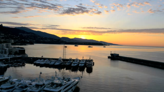 aerial drone monte carlo sunset luxury boat travel - monaco stock-videos und b-roll-filmmaterial