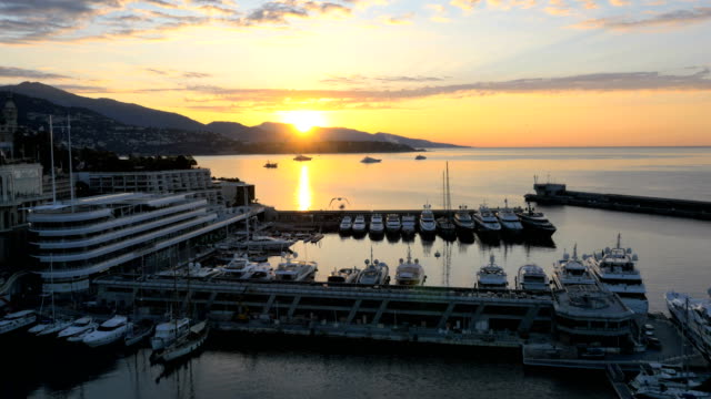 aerial drone monte carlo sunset luxury wealth boat - jachthafen stock-videos und b-roll-filmmaterial