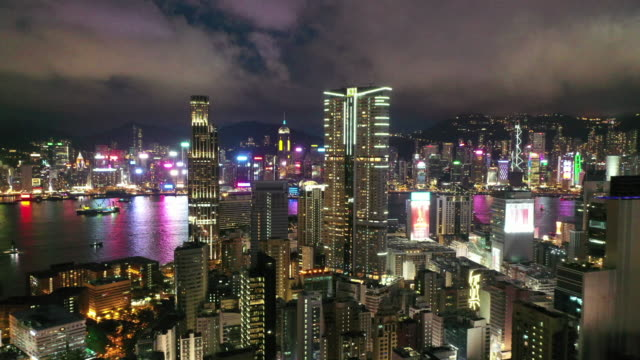 aerial drone movie flying over the skyscrapers and the bay at victoria peak, hong kong - victoria harbour hong kong stock videos & royalty-free footage