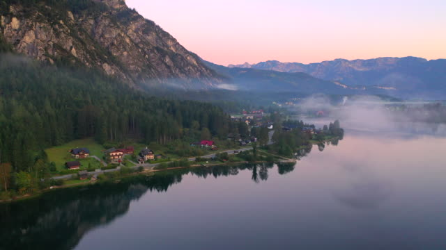 aerial drone movie of sunrise scene with morning fog around gosauseen lake, splendid morning view of austrian alps, upper austria, europe - upper austria stock videos & royalty-free footage